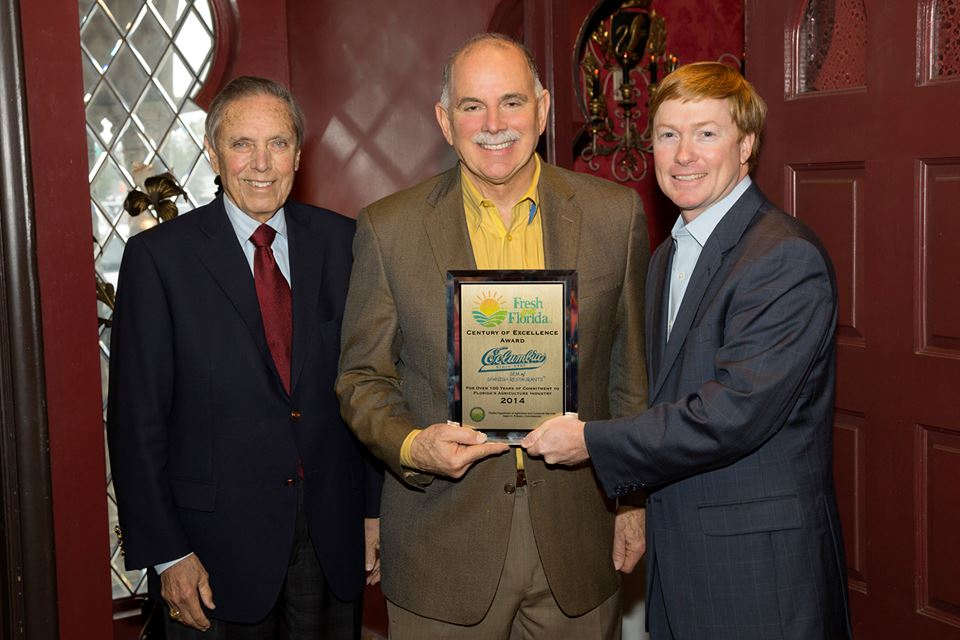 "State Agriculture Commissioner Adam Putnam presents the ""Century of Excellence"" award to Columbia fourth generation owner Richard Gonzmart, joined by former governor Bob Martinez.  The award, part of the Fresh from Florida campaign, marks the Columbia's use of state produce and the upcoming menu for Gonzmart's new restaurant, Ulele."